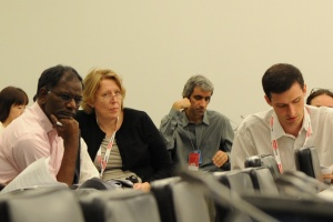 Dr. Matthew Bolton (right), Pace University New York City Model UN faculty advisor, examines draft of the Arms Trade Treaty during the Diplomatic Conference at the UN in July 2012.