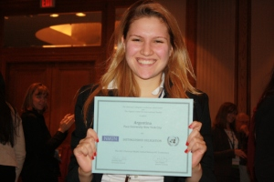 Katie James '14, Pace University New York City Model UN head delegate, shows of the award received by the students representing ?? at the 2013 National Model UN conference in Washington DC.