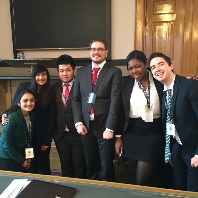Pace New York City Model UN students (Priya Sakaria '17 and Jennifer Diaz '16 on the left and Shade Quailey '15 and Niall O'Reilly '16 on the right) who participated in the simulation of the United Nations Human Rights Council with their committee chairs (in the center)..
