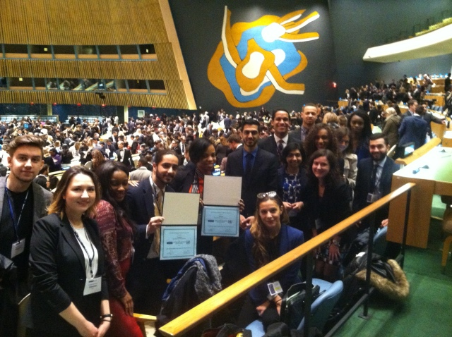 The Pace NYC Model United Nations students in the UN General Assembly Room after the Closing Ceremony of the 2015 National Model UN conference in New York City.