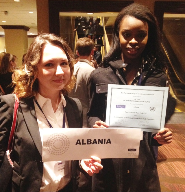 Pace students Latrelle Gray Jones-Booker and Syuyumbika Galimova display their Outstanding Position Paper award at the 2015 National Model United Nations conference in New York City.