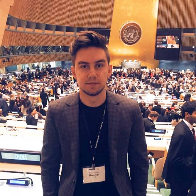 Pace student Oleh Puryshev in the United Nations General Assembly Room during the 2015 National Model UN conference in New York City.