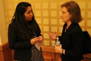 Pace University New York City student Ingrid Soto Tornero talks with a guest speaker from the US State Department at the 2015 National Model UN conference in Washington DC.